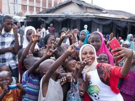 Asisat Oshoala Releases An Awe-Inspiring Photo Donating Food To Children And Her Youth Foundation